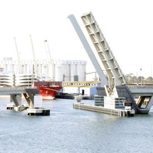 Image: large bridge open to let vessel through